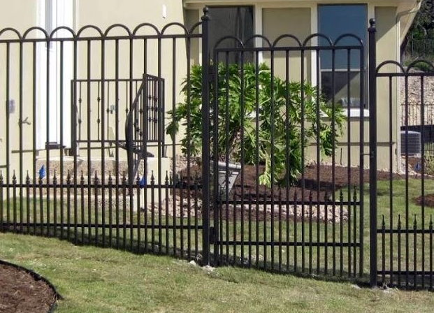 Ornamental fence with puppy pickets